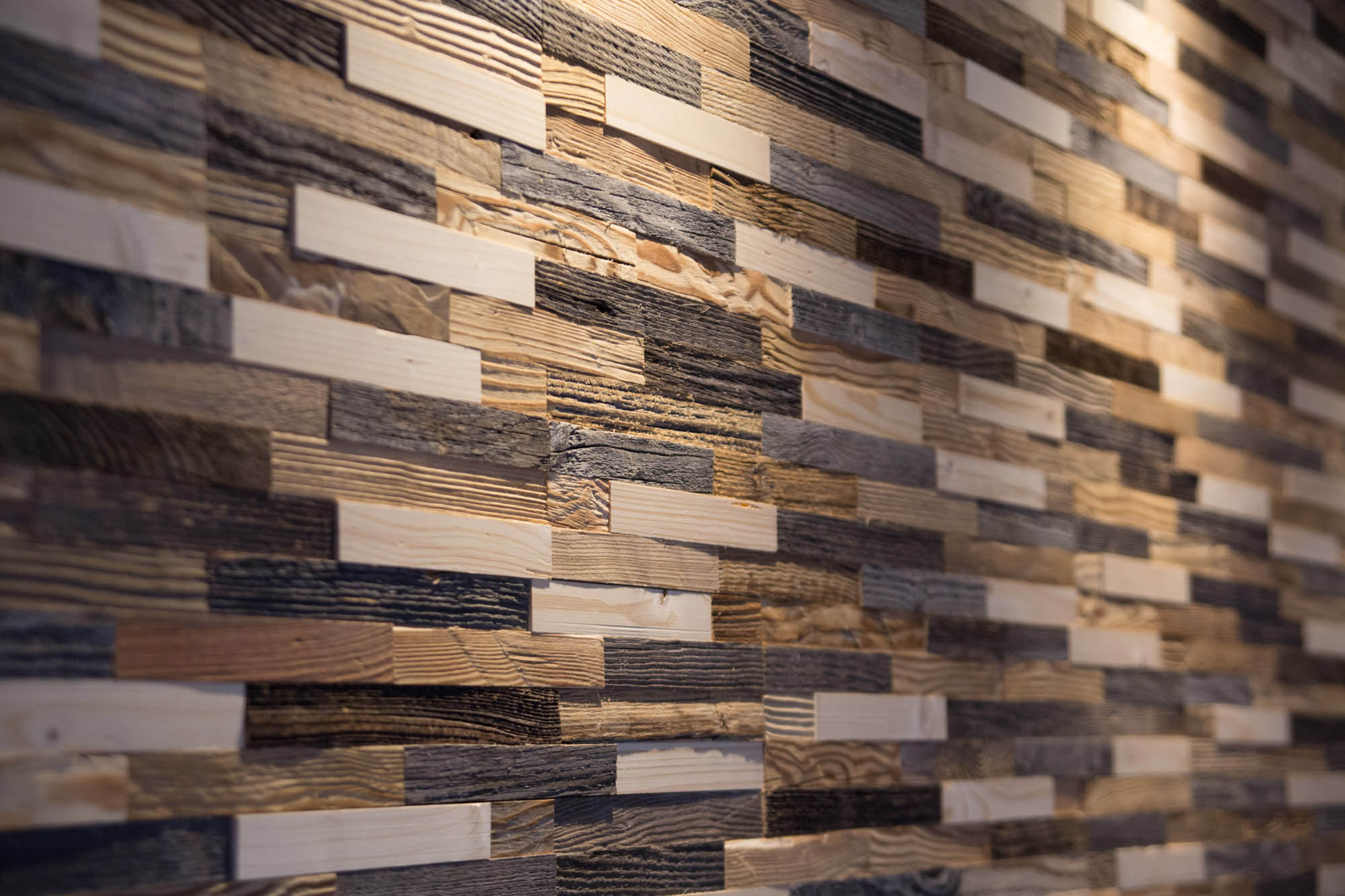 Reclaimed wood wall panel from different types of wood
