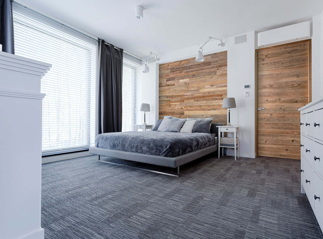 Reclaimed wood wall behind bed and in doors