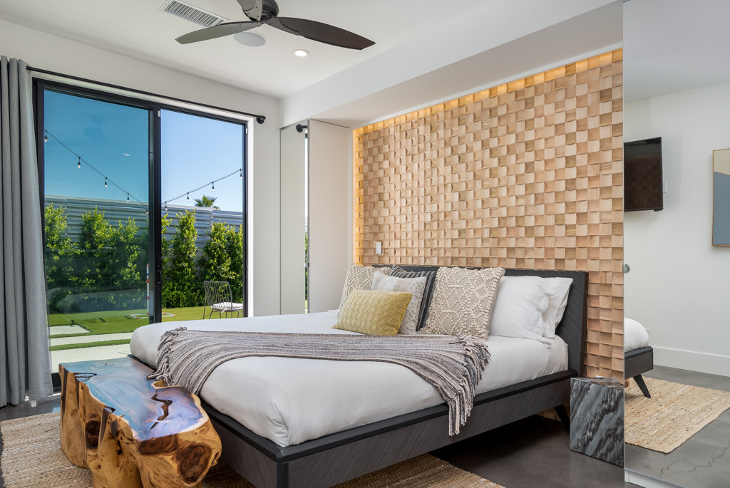 Solid wood wall panel in bedroom interior