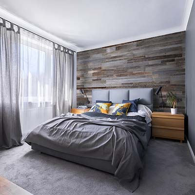 Grey bed with grey wall panels