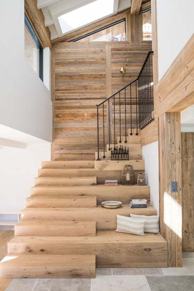 Reclaimed boards and beams in alps house interior
