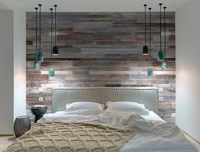 Bedroom wall covered with wood boards in grey color
