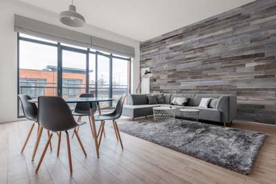 Wall panel in apartment with large windows
