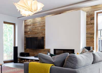 reclaimed wood behind tv white interior